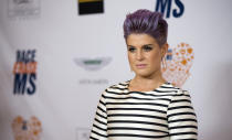 Television personality Kelly Osbourne poses at the 21st annual Race To Erase MS fundraiser in Los Angeles, California May 2, 2014. The acronym MS refers to the inflammatory disease multiple sclerosis. REUTERS/Mario Anzuoni (UNITED STATES - Tags: ENTERTAINMENT)