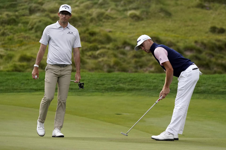 Justin Thomas, right, reacts after putting on the 18th hole next to Dylan Frittelli during the third round of the Zozo Championship golf tournament Saturday, Oct. 24, 2020, in Thousand Oaks, Calif. (AP Photo/Marcio Jose Sanchez)