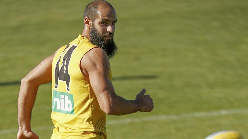 Bachar Houli will miss the opening round of the AFL after limping out of training