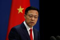 FILE PHOTO: Chinese Foreign Ministry spokesman Zhao Lijian attends a news conference in Beijing, China