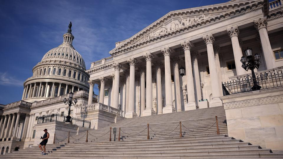 A person runs on the steps of the U.S. Capitol Building on Monday in Washington, D.C.