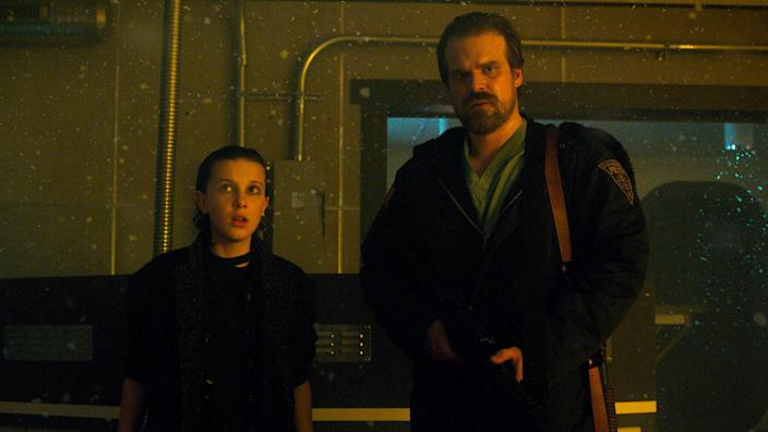 Millie Bobby Brown and David Harbour in the second season of <i>Stranger Things</i> (Netflix)