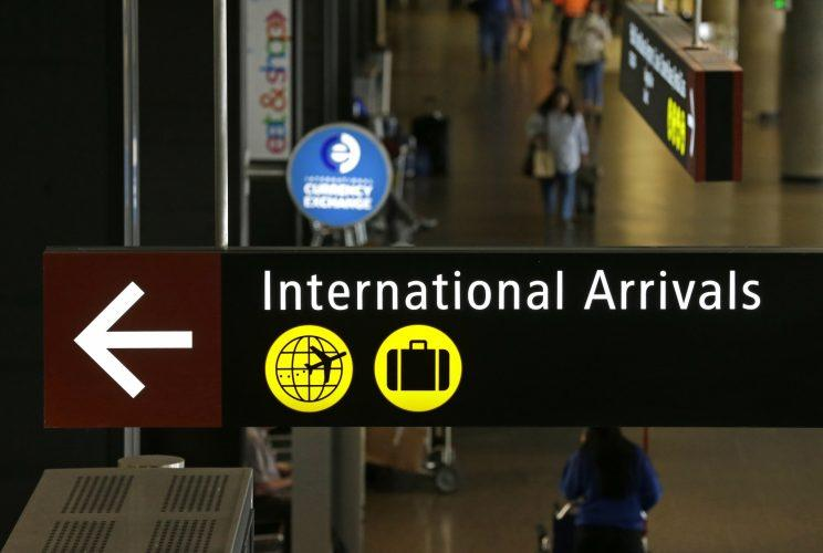 international arrivals sign from airport
