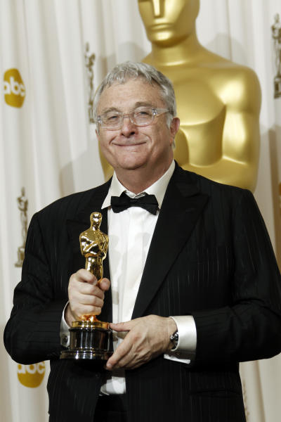 "FILE - This Feb. 27, 2011, file photo shows composer Randy Newman posing backstage with the Oscar for best original song for ""We Belong Together"" from ""Toy Story 3"" at the 83rd Academy Awards in the Hollywood section of Los Angeles. Newman is weighing in on the presidential election, and he's playing the race card through a song he wrote. I'm Dreaming"" is full of satirical, sarcastic _ and signature Newman _ anecdotes about someone who votes for the president because he is white. It features the refrain: ""I'm dreaming of a white president."" Newman is openly supporting President Barack Obama. He says though the song is serious, he wants the public to find comedic relief in it. (AP Photo/Matt Sayles, File)"