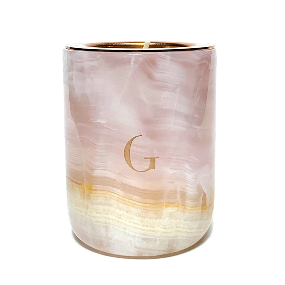 """<p><strong>Gilded</strong></p><p>gildedbody.com</p><p><strong>$68.00</strong></p><p><a href=""""https://gildedbody.com/collections/the-marble-candle/products/pink-onyx-marble-candle"""" rel=""""nofollow noopener"""" target=""""_blank"""" data-ylk=""""slk:Shop Now"""" class=""""link rapid-noclick-resp"""">Shop Now</a></p><p>It'll be hard to part ways with this pink onyx vessel once it finishes burning. And you don't have to, thanks to the refillable design.</p>"""