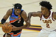 Oklahoma City Thunder's Shai Gilgeous-Alexander, left, drives past Cleveland Cavaliers' Collin Sexton in the second half of an NBA basketball game, Sunday, Feb. 21, 2021, in Cleveland. (AP Photo/Tony Dejak)