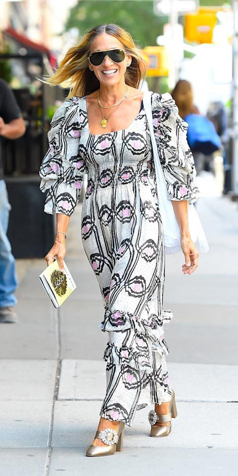 "<p>Sarah Jessica Parker solidified her fashion icon status in a printed dress and <a href=""https://www.amazon.com/SJP-Sarah-Jessica-Parker-Womens/dp/B077Y93ZT3?ie=UTF8&camp=1789&creative=9325&linkCode=as2&creativeASIN=B077Y93ZT3&tag=instycom00-20&ascsubtag=d41d8cd98f00b204e9800998ecf8427e"" target=""_blank"">metallic SJP by Sarah Jessica Parker heels</a>.</p>"