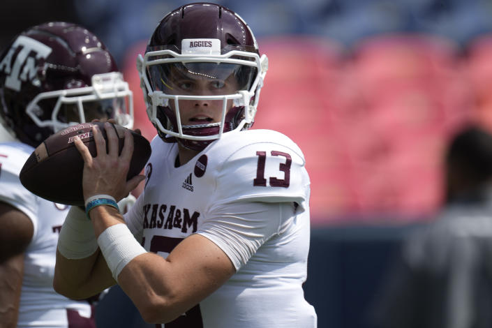 Texas A&M quarterback Haynes King warms up before the first half of an NCAA college football game against Colorado, Saturday, Sept. 11, 2021, in Denver. (AP Photo/David Zalubowski)