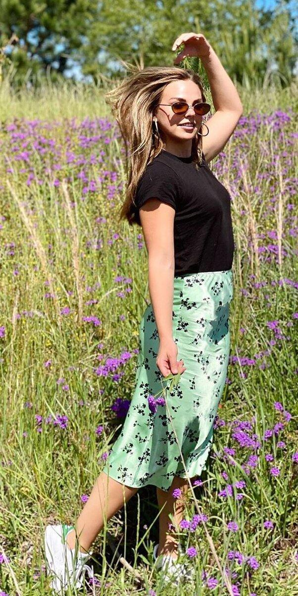 """<p>While most ex-bachelor and ex-bachelorette contestants are making fools of themselves on various social media platforms, Hannah Brown is showing she's above it all in cute lil' fits in lavender fields. Brown did a hair flip in nature while wearing a Topshop satin-silk skirt (<strong>Shop similar:</strong> $186; <a href=""""https://click.linksynergy.com/deeplink?id=93xLBvPhAeE&mid=1237&murl=https%3A%2F%2Fshop.nordstrom.com%2Fs%2Fvince-satin-slip-skirt%2F5649702%3F&u1=IS%2CHannahBrown%2Canesta%2C%2CIMA%2C3545490%2C202005%2CI"""" rel=""""nofollow noopener"""" target=""""_blank"""" data-ylk=""""slk:nordstrom.com"""" class=""""link rapid-noclick-resp"""">nordstrom.com</a>), Adidas Stan Smith sneakers (<strong>Shop now:</strong> $80; <a href=""""https://click.linksynergy.com/deeplink?id=93xLBvPhAeE&mid=1237&murl=https%3A%2F%2Fshop.nordstrom.com%2Fs%2Fadidas-stan-smith-sneaker-women%2F3842428%3F&u1=IS%2CHannahBrown%2Canesta%2C%2CIMA%2C3545490%2C202005%2CI"""" rel=""""nofollow noopener"""" target=""""_blank"""" data-ylk=""""slk:nordstrom.com"""" class=""""link rapid-noclick-resp"""">nordstrom.com</a>) and Prive Revaux sunglasses (<strong>Shop now: </strong>$30; <a href=""""http://www.anrdoezrs.net/links/7799179/type/dlg/sid/IS%2CHannahBrown%2Canesta%2C%2CIMA%2C3545490%2C202005%2CI/https://priverevaux.com/products/heat-up?"""" rel=""""nofollow noopener"""" target=""""_blank"""" data-ylk=""""slk:priverevaux.com"""" class=""""link rapid-noclick-resp"""">priverevaux.com</a>). And unlike <a href=""""https://priverevaux.com/products/heat-up?"""" rel=""""nofollow noopener"""" target=""""_blank"""" data-ylk=""""slk:with pilot Peter's Tik Toks"""" class=""""link rapid-noclick-resp"""">with pilot Peter's Tik Toks</a>, we love to see it. </p>"""