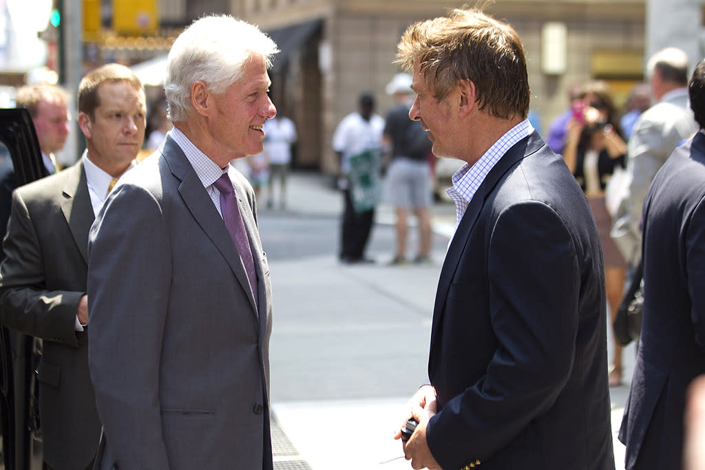 "Though ""30 Rock"" star Alec Baldwin has been making headlines lately for getting into a scuffle with a photographer in New York City, he had a much more pleasant encounter on the streets of Manhattan on Wednesday when he bumped into former President Bill Clinton. The two men shook hands, hugged, and chatted for a bit. (6/20/2012)"