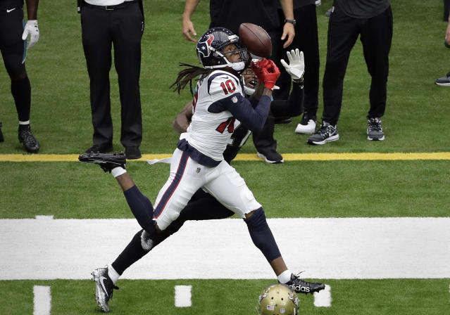 <p>Houston Texans wide receiver DeAndre Hopkins (10) bobbles a pass as Jacksonville Jaguars cornerback A.J. Bouye defends on the play during the first half of an NFL football game Sunday, Sept. 10, 2017, in Houston. (AP Photo/Eric Gay) </p>