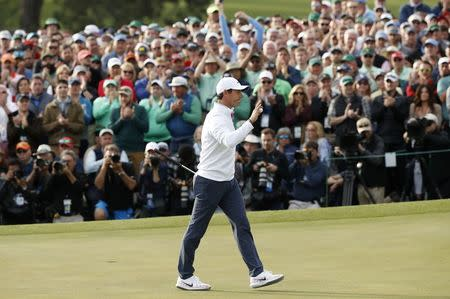 Rory McIlroy of Northern Ireland acknowledges the crowd after finishing on the 18th green during final round play of the 2018 Masters golf tournament at the Augusta National Golf Club in Augusta, Georgia, U.S. April 8, 2018. REUTERS/Mike Segar