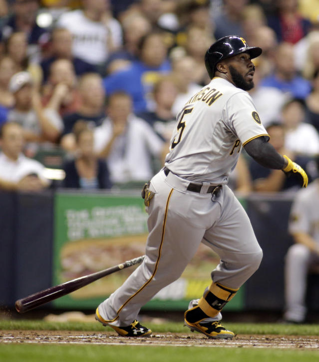 Pittsburgh Pirates' Josh Harrison watches the ball after he hit a two-run RBI double against the Milwaukee Brewers during the second inning of a baseball game Friday, Aug. 22, 2014, in Milwaukee. (AP Photo/Darren Hauck)