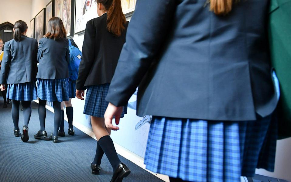 A headteacher sent an email to pupils discouraging them missing school because of their periods - Ben Birchall/PA