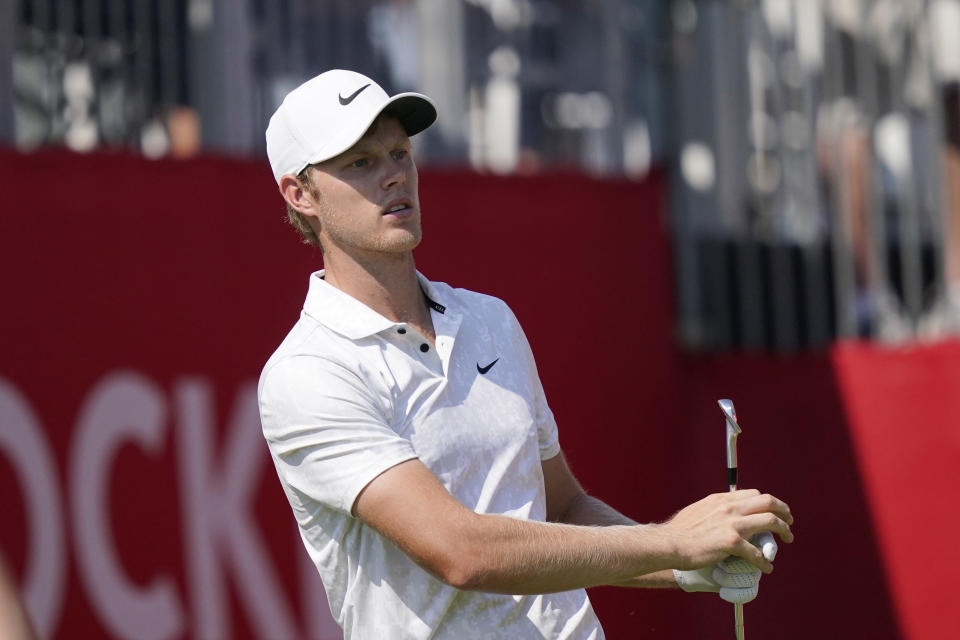 Cam Davis watches his drive off the 15th tee during the third round of the Rocket Mortgage Classic golf tournament, Saturday, July 3, 2021, at the Detroit Golf Club in Detroit. (AP Photo/Carlos Osorio)