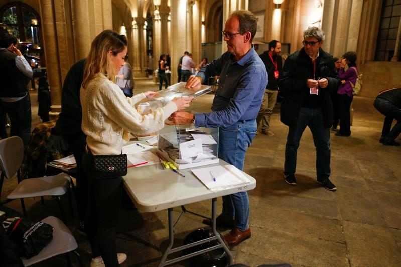 The ballots boxes are opened to count votes during general election in Barcelona