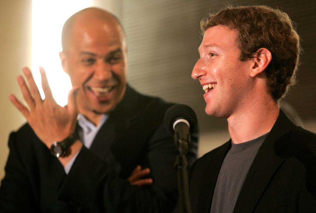 Newark's then-Mayor Cory Booker, left, and Mark Zuckerberg, founder and CEO of Facebook, talk about Zuckerberg's donation of $100 million to help Newark public schools on Sept. 25, 2010. (Photo: AP/Rich Schultz)