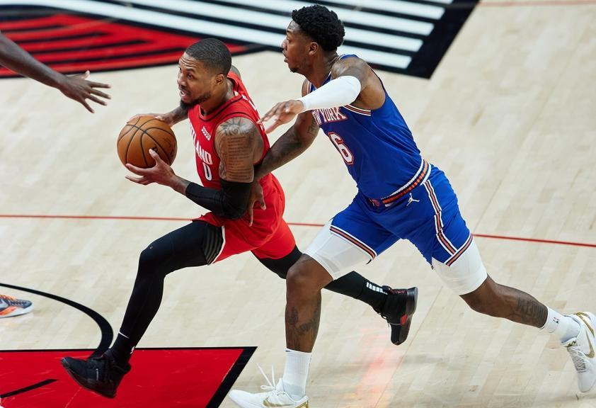 Damian Lillard drives on Elfrid Payton