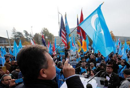 Dolkun Isa, President of the World Uyghur Congress, gestures as he speaks during a demonstration against China during its Universal Periodic Review by the Human Rights Council in front of the United Nations Office in Geneva, Switzerland, November 6, 2018. REUTERS/Denis Balibouse