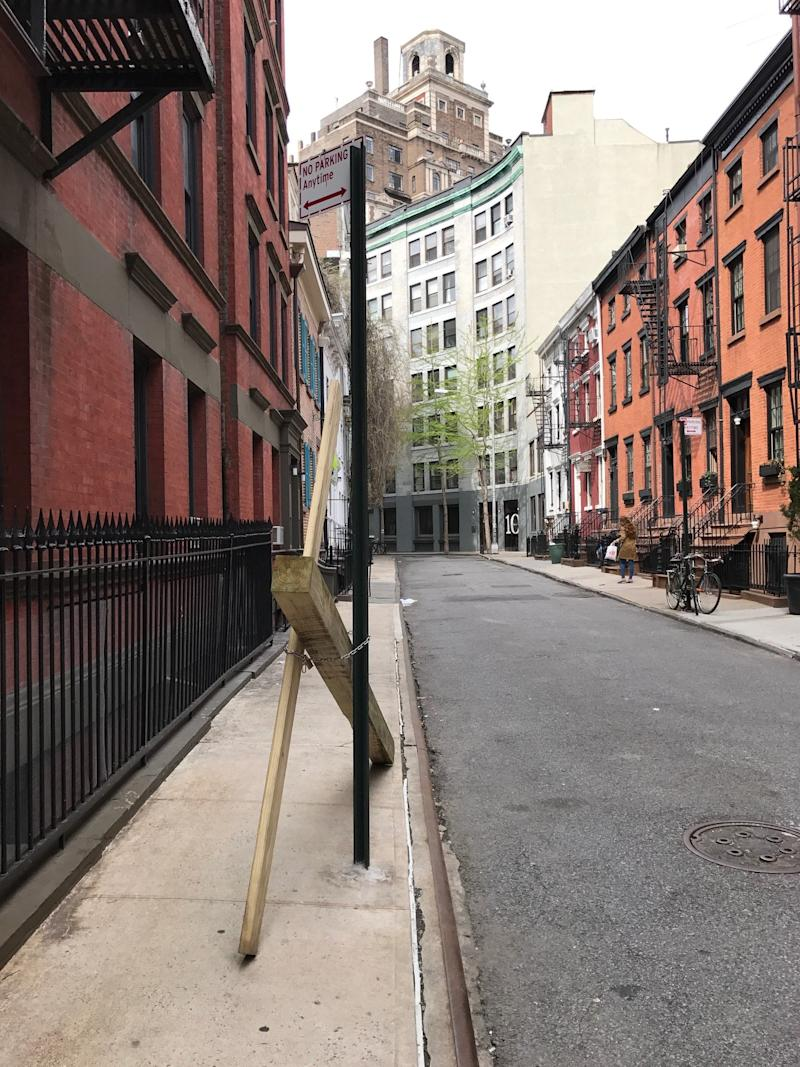 Someone Chained a Cross on New York's Gay Street -So a Band of Neighbors Redecorated It