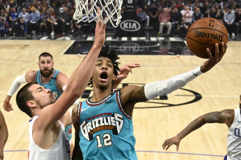 Memphis Grizzlies guard Ja Morant, right, shoots as Los Angeles Clippers center Ivica Zubac defends during the first half of an NBA basketball game Monday, Feb. 24, 2020, in Los Angeles. (AP Photo/Mark J. Terrill)