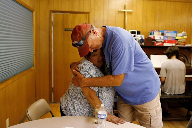 <p>Pastor Craig Paschal (R), hugs Blanca Estela Valdivia, 70, mother of immigrant Rosa Sabido who is living in sanctuary in the United Methodist Church while facing deportation, in Mancos, Colo., July 19, 2017. (Photo: Lucy Nicholson/Reuters) </p>