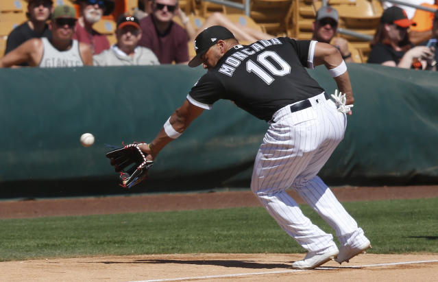 FILE - In this Monday, March 18, 2019, file photo, Chicago White Sox infielder Yoan Moncada reaches for a foul ball hit by San Francisco Giants' Pablo Sandoval in the fifth inning of a spring training baseball game in Glendale, Ariz. The White Sox are counting on young players such as infielder Yoan Moncada. (AP Photo/Sue Ogrocki, File)