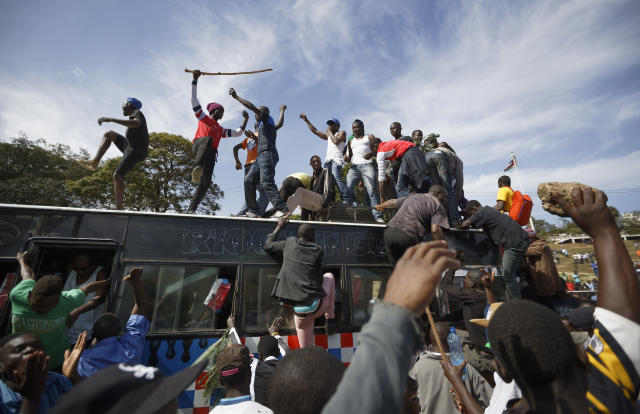 "<p>Supporters of opposition leader Raila Odinga arrive by bus, as they gather in advance of a mock ""swearing-in"" ceremony of Odinga at Uhuru Park in downtown Nairobi, Kenya Tuesday, Jan. 30, 2018. (Photo: Ben Curtis/AP) </p>"