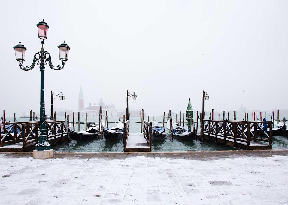 """<a href=""""https://www.cntraveler.com/destinations/venice?mbid=synd_yahoo_rss"""" rel=""""nofollow noopener"""" target=""""_blank"""" data-ylk=""""slk:Venice"""" class=""""link rapid-noclick-resp"""">Venice</a> has become notoriously overrun during peak season—just see its recent <a href=""""https://www.cntraveler.com/story/the-other-side-of-venices-overtourism-problem?mbid=synd_yahoo_rss"""" rel=""""nofollow noopener"""" target=""""_blank"""" data-ylk=""""slk:attempts to limit tourist numbers"""" class=""""link rapid-noclick-resp"""">attempts to limit tourist numbers</a> for proof. But come wintertime, the city actually lives up to its La Serenissima (""""The Serene"""") nickname. The canals are quiet and shrouded in mist, hotels give discounted rates, and you can actually visit St. Mark's Basilica without a stranger's selfie stick poking you in the eye."""