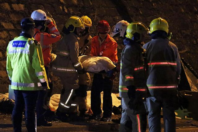 <p>Rescuers carry a body after a bus crashed in Hong Kong, China, Feb. 10, 2018. (Photo: Bobby Yip/Reuters) </p>