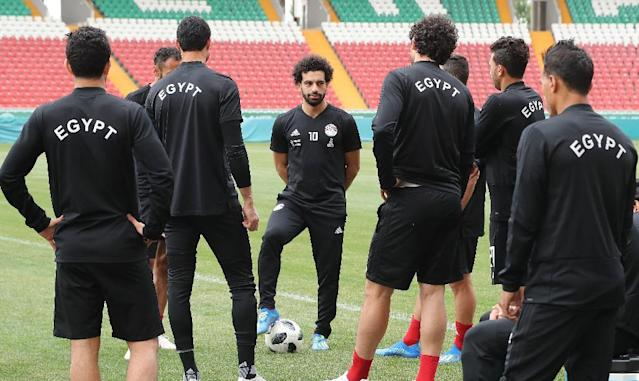 Egypt's Mohamed Salah (C) missed his team's defeat to Uruguay as he struggles to recover from the shoulder injury sustained during last month's Champions League Final (AFP Photo/KARIM JAAFAR)