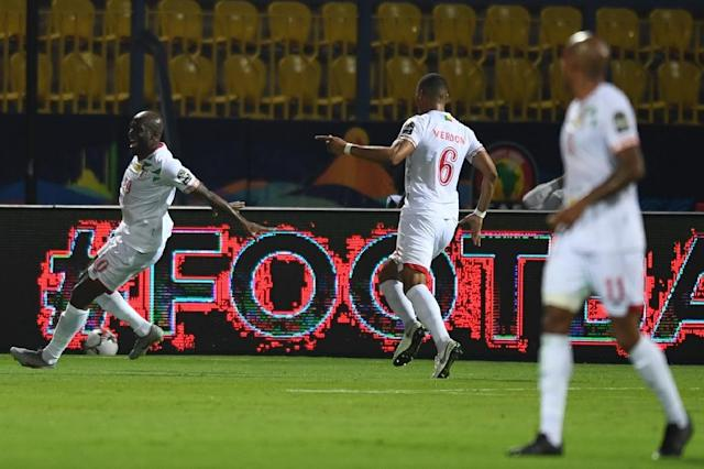 Benin's forward Mickael Pote (L) celebrates his second goal during the 2019 Africa Cup of Nations football match between Ghana and Benin (AFP Photo/OZAN KOSE)