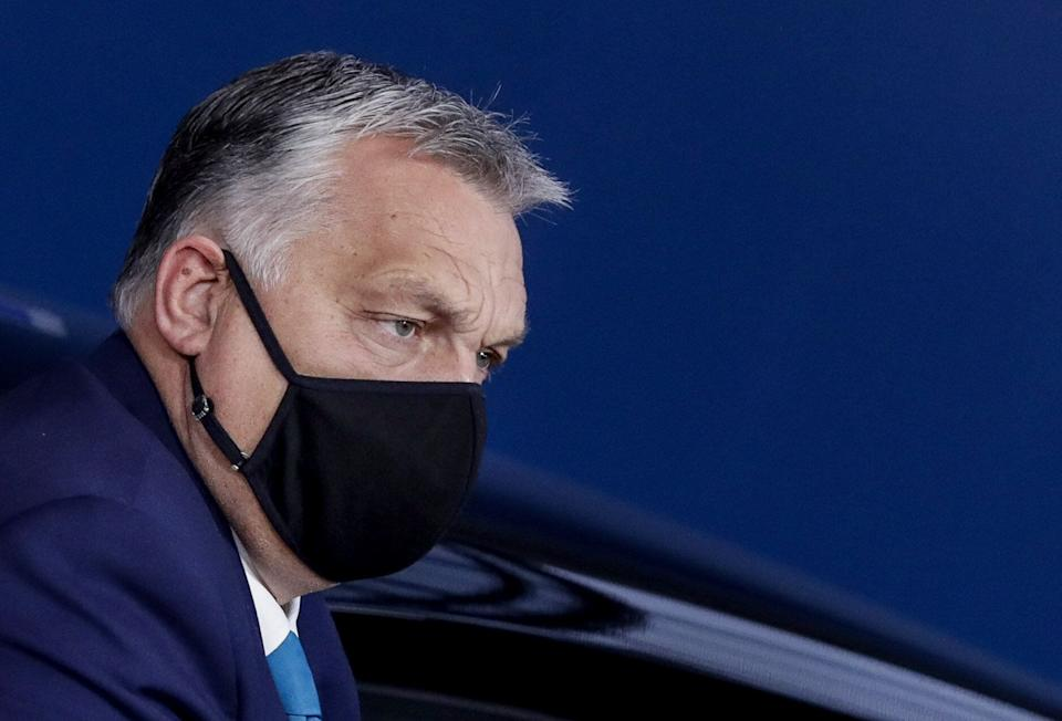 Hungarian Prime Minister Viktor Orban, wearing a face mask, arrives on the second day of a two days face-to-face EU summit, in Brussels, on October 16, 2020. (Photo by Olivier HOSLET / POOL / AFP) (Photo by OLIVIER HOSLET/POOL/AFP via Getty Images) (Photo: OLIVIER HOSLET via Getty Images)