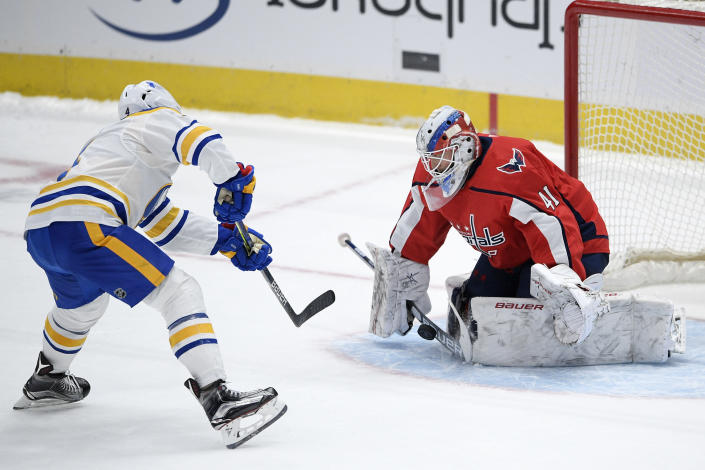 Washington Capitals goaltender Vitek Vanecek (41) stops a shot by Buffalo Sabres left wing Taylor Hall (4) during the shootout of an NHL hockey game, Friday, Jan. 22, 2021, in Washington. (AP Photo/Nick Wass)