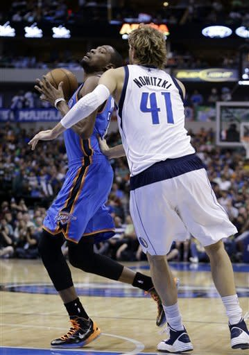 Oklahoma City Thunder forward Kevin Durant (35) is fouled by Dallas Mavericks forward Dirk Nowitzki (41) of Germany during the first half of an NBA basketball game Sunday, March 17, 2013, in Dallas. (AP Photo/LM Otero)
