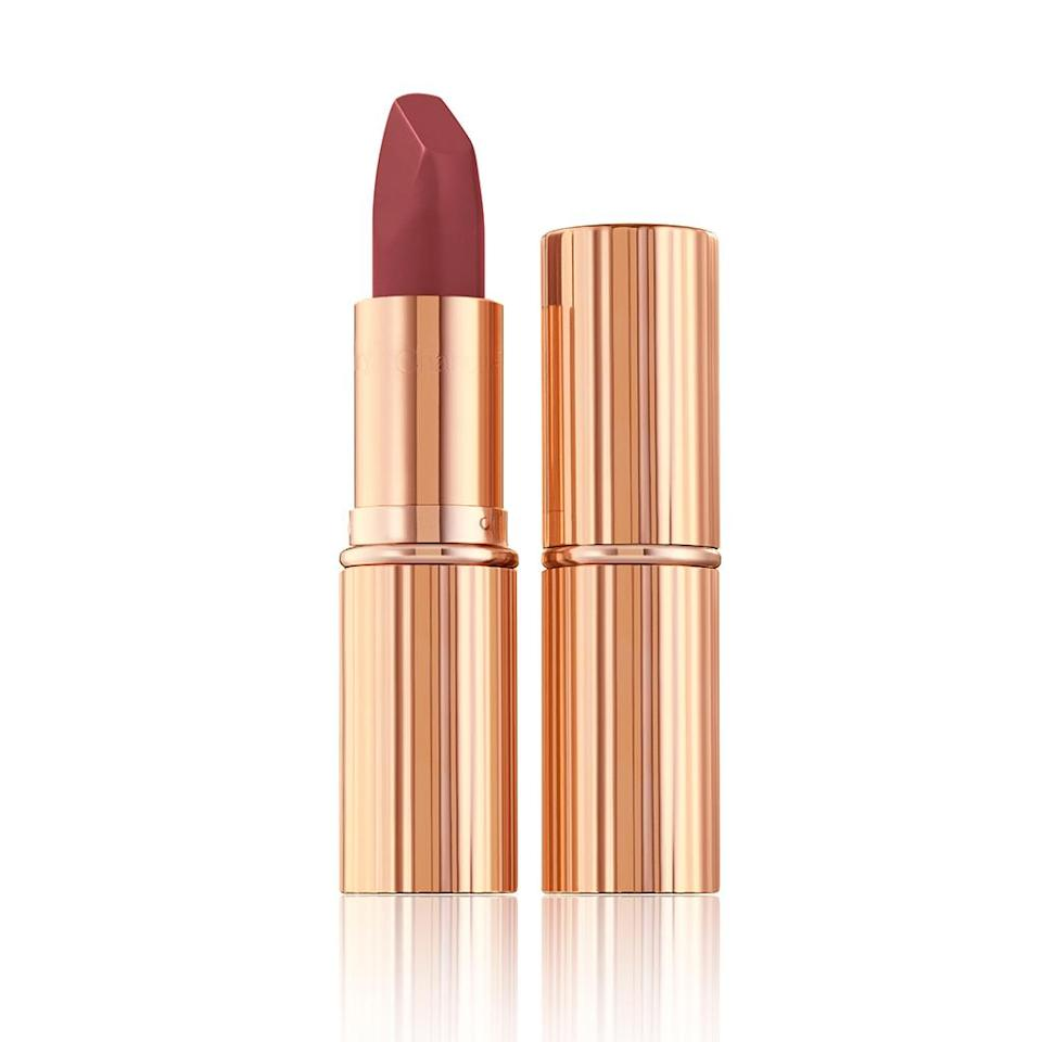 """<p><strong><em>Sarah Ball, Market Editor:</em></strong> This shade is the perfect day-to-night lipstick. It adds just enough color to my lips without being too bold for daytime and I love how it complements my skin tone and goes with anything I wear. It's also matte, so it doesn't smear or look too shimmery, but also doesn't make my lips dry. It's truly the only lipstick I buy!</p> <p><strong>Buy It!</strong> Charlotte Tilbury Pillow Talk Lipstick in Pillow Talk Medium, $34; <a href=""""http://prf.hn/click/camref:1011l5epi/pubref:PEOInHonorofNationalLipstickDaytheFormulasOurEditorsLoveRightNowjfields1271StyGal12825911202107I/destination:https%3A%2F%2Fwww.charlottetilbury.com%2Fus%2Fproduct%2Fmatte-revolution-lipstick-pillow-talk-medium-2"""" rel=""""sponsored noopener"""" target=""""_blank"""" data-ylk=""""slk:charlottetilbury.com"""" class=""""link rapid-noclick-resp"""">charlottetilbury.com</a></p>"""