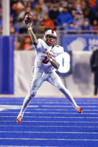 New Mexico quarterback Tevaka Tuioti throws a pass during the first half of the team's NCAA college football game against Boise State, Saturday, Nov. 16, 2019, in Boise, Idaho. (AP Photo/Steve Conner)