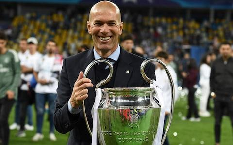 Real Madrid's French coach Zinedine Zidane holds the trophy as he celebrates winning the UEFA Champions League final football match between Liverpool and Real Madrid - Credit: AFP PHOTO / FRANCK FIFE