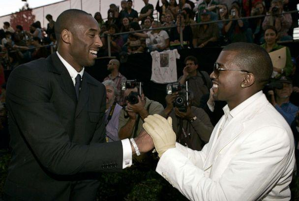 PHOTO: In this Nov. 14, 2004, file photo, Kobe Bryant and Kanye West greet each other on the red carpet before the 32nd Annual American Music Awards in Los Angeles. (K. Mazur/WireImage via Getty Images, FILE)