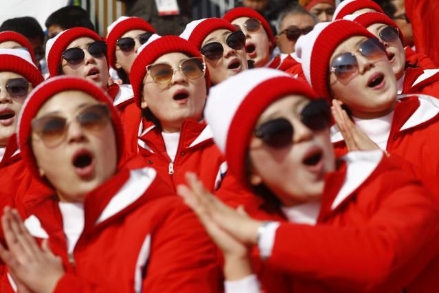 Alpine Skiing - Pyeongchang 2018 Winter Olympics - Men's Giant Slalom - Yongpyong Alpine Centre - Pyeongchang, South Korea - February 18, 2018 - North Korean cheerleaders applaud. REUTERS/Kai Pfaffenbach