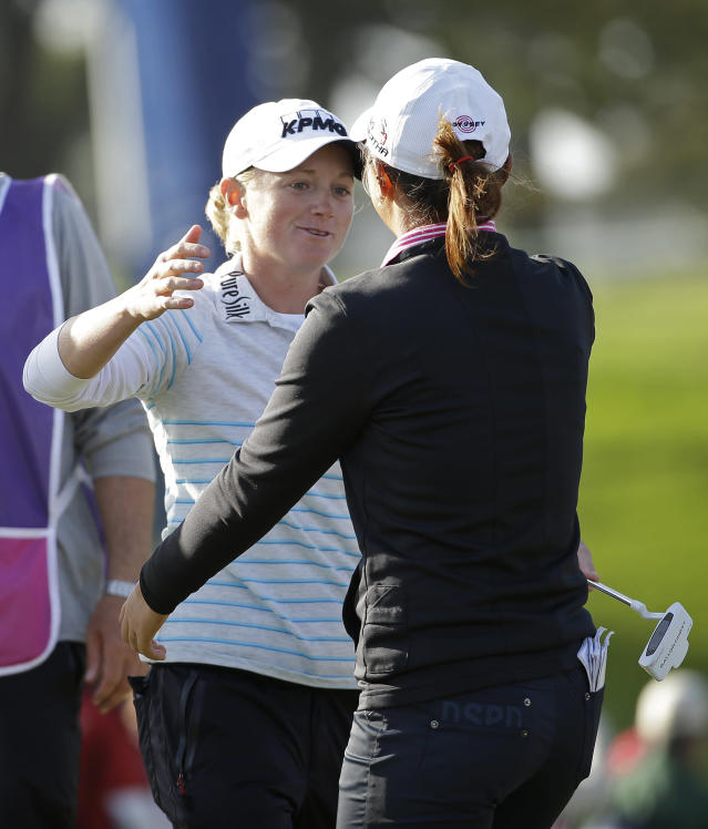 Stacy Lewis, left, greets Lydia Ko, right, of New Zealand on the 18th green of the Lake Merced Golf Club after the final round of the Swinging Skirts LPGA Classic golf tournament on Sunday, April 27, 2014, in Daly City, Calif. Ko won the event after shooting a 3-under-par 69 to finish at 12-under-par and Lewis finished second. (AP Photo/Eric Risberg)