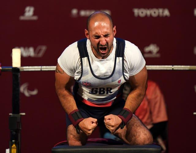 Great Britain's Ali Jawad celebrates after the second lift in the men's -59 kg final