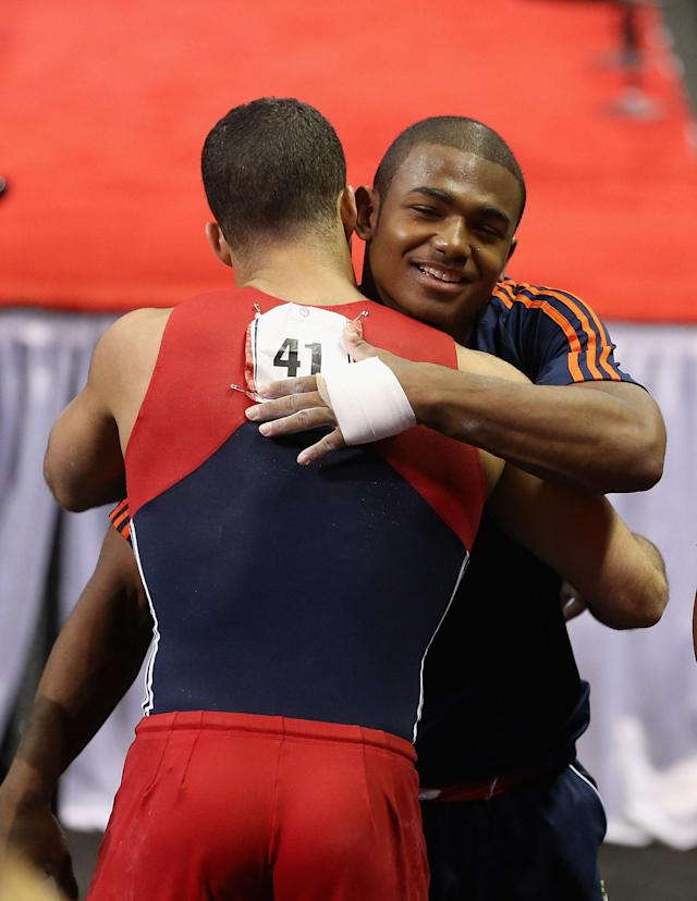 SAN JOSE, CA - JUNE 30: John Orozco hugs Danell Leyva after Leyva competed on the parallel bars during day 3 of the 2012 U.S. Olympic Gymnastics Team Trials at HP Pavilion on June 30, 2012 in San Jose, California. (Photo by Ezra Shaw/Getty Images)
