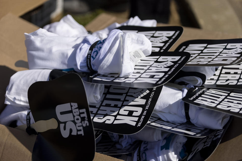 Black Voters Matter fans, shirts and wristbands were distributed along with food and toys as part of the program in the John Lewis Advancement Act Day of Action, a voter education and engagement event Saturday, May 8, 2021, at Carver High School in Montgomery, Ala. (AP Photo/Vasha Hunt)