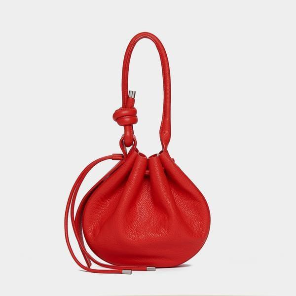 <p>Behno's chic bags are designed in New York and made in India. The company is trying to create a new standard of manufacturing in India by improving its workers' quality of life along with factory conditions. </p> <p><strong>What We'd Buy</strong>: <span>Behno Ina Bag in Pebble Red</span> ($495)</p>