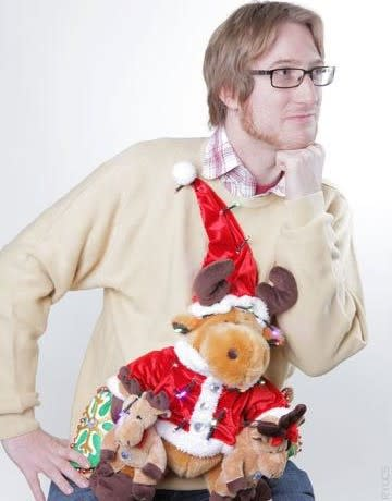 """<div class=""""caption-credit"""">Photo by: Rock Your Ugly Christmas Sweater</div>Co-author Brian Clark Howard wearing his favorite ugly Christmas sweater, complete with singing and dancing stuffed reindeer, made by co-author Anne-Marie Blackman."""