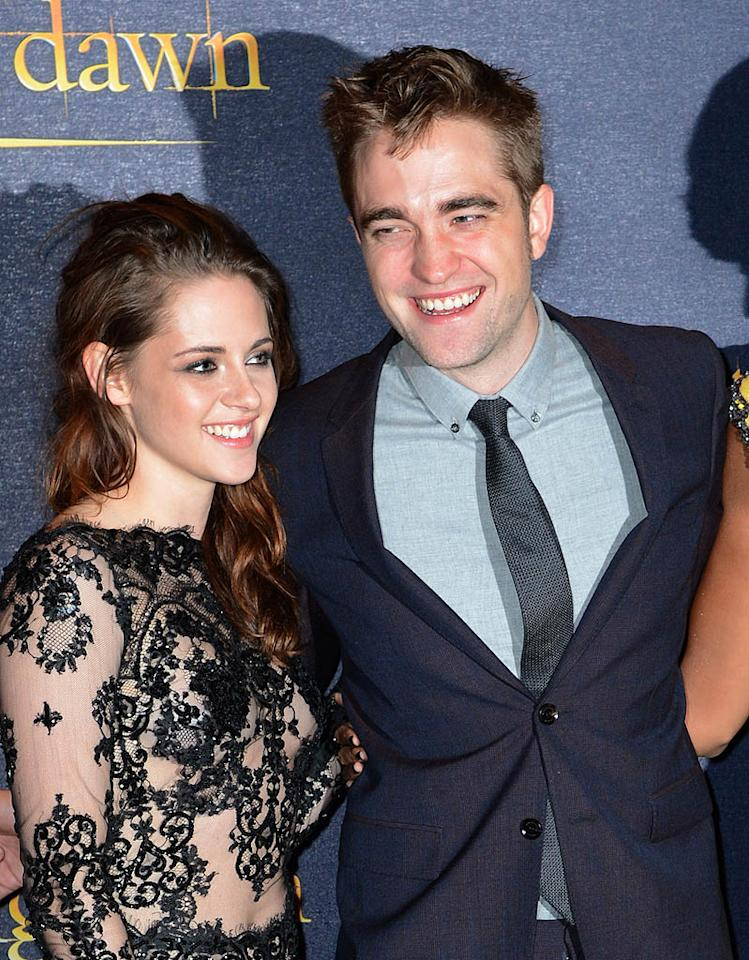 """Cheating? What cheating? Kristen Stewart and Robert Pattinson looked happily back together when they hit the U.K. premiere of """"The Twilight Saga: Breaking Dawn <span style=""""font-size:11.0pt;"""">– </span>Part 2"""" on Wednesday night, where Kristen wore her second sexy skin-baring lace ensemble of the week. (11/14/2012)"""
