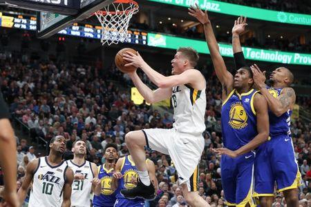 Apr 10, 2018; Salt Lake City, UT, USA; Utah Jazz forward Jonas Jerebko (8) gets past Golden State Warriors forward Kevon Looney (5) and forward David West (3) and goes to the basket during the second half at Vivint Smart Home Arena. Utah Jazz won 119-79. Mandatory Credit: Chris Nicoll-USA TODAY Sports