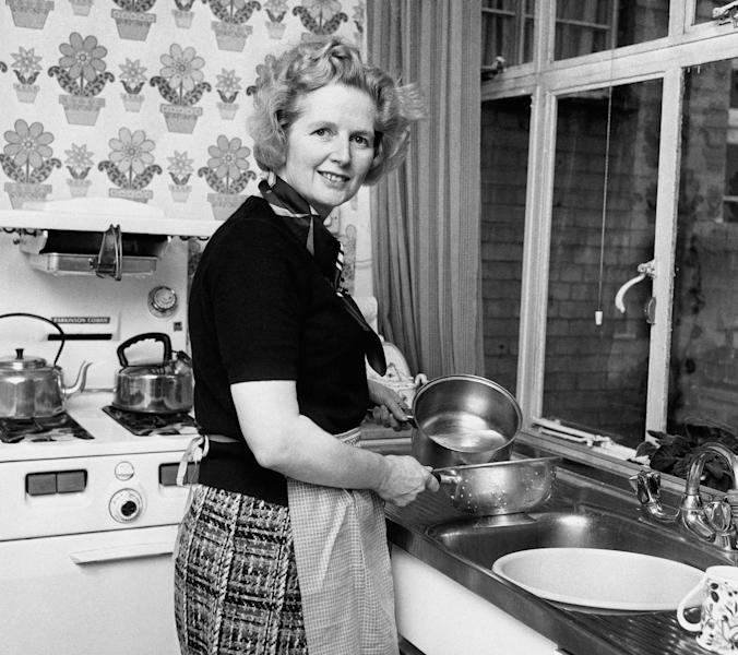"FILE - Feb, 1, 1975 file photo of the them Conservative Member of Parliament Margaret Thatcher, in her Chelsea home kitchen. She was Britain's first female leader, a strong woman who battled her way to the top of a male-dominated political system _ but don't call Margaret Thatcher a feminist. The former prime minister, who died Monday aged 87, rejected the label _ ""I owe nothing to women's lib,"" she once said _ and she leaves a contested legacy for women. (AP Photo/ PA/File) UNITED KINGDOM OUT"