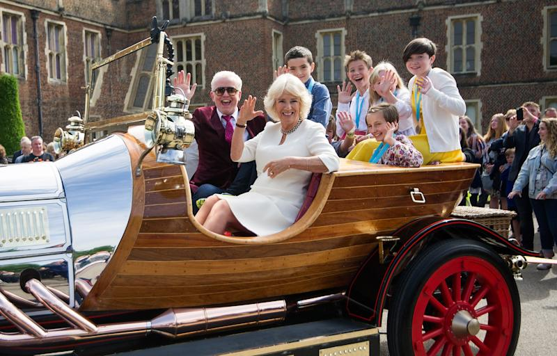 LONDON, ENGLAND - JUNE 08: Camilla, Duchess of Cornwall and Chris Evans depart in 'Chitty Chitty Bang Bang' after attending the live broadcast of the final of BBC Radio 2's 500 Words creative writing competition along with the winning children at Hampton Court Palace on June 8, 2018 in London, England. (Photo by Tim P. Whitby/Tim P. Whitby/Getty Images)